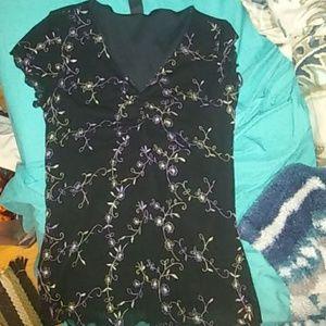 Wrapper Tops - A black flowered shirt
